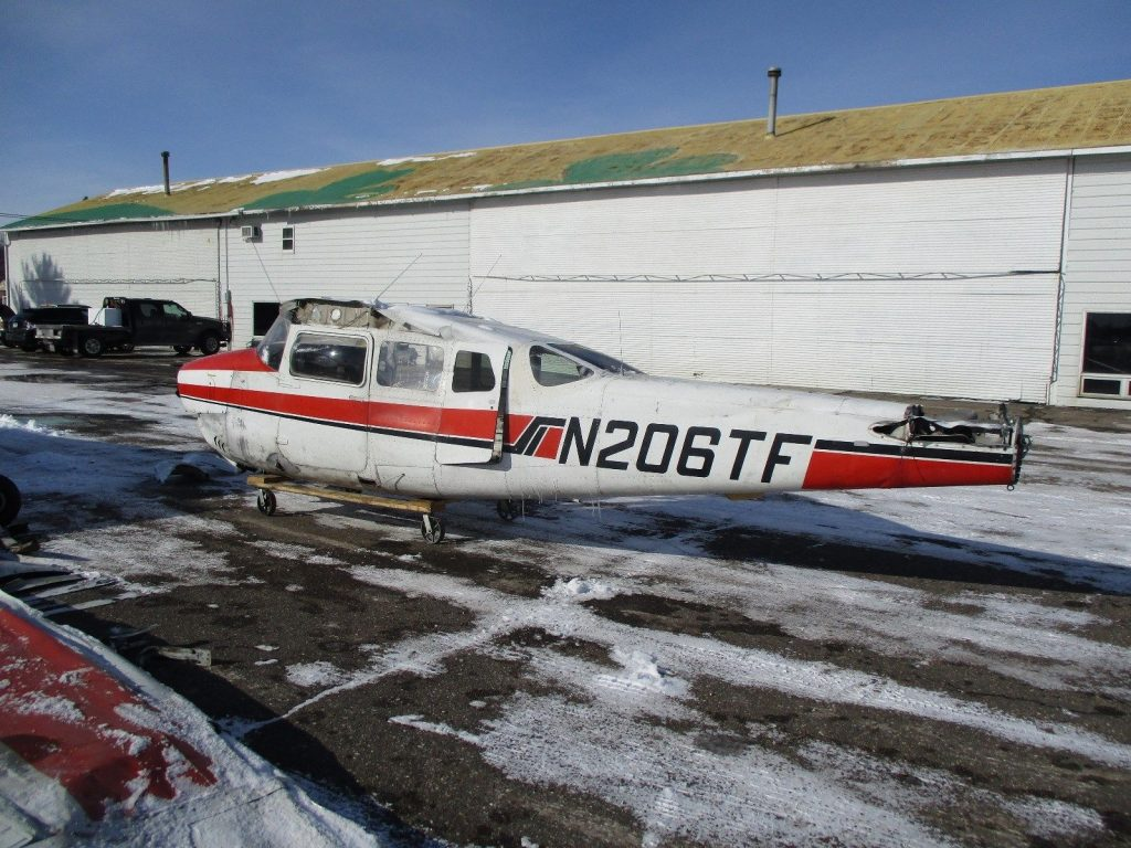 damaged 1966 Cessna P206 aircraft