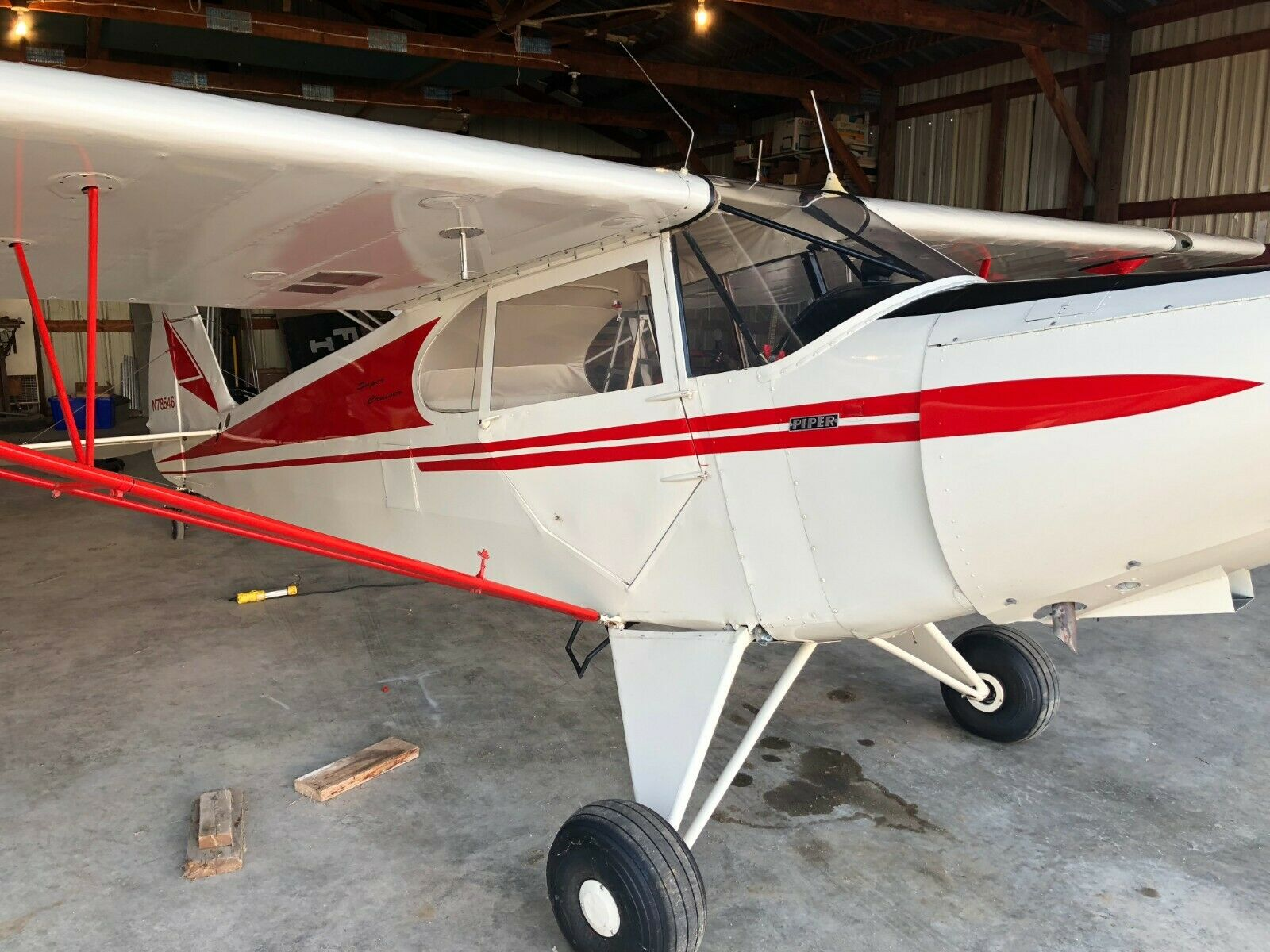 hangared 1947 Piper PA 12 Super Cruiser aircraft for sale